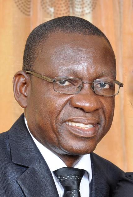 Dr Sam Okere